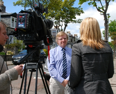 Photo of Ian Yuill and TV camera