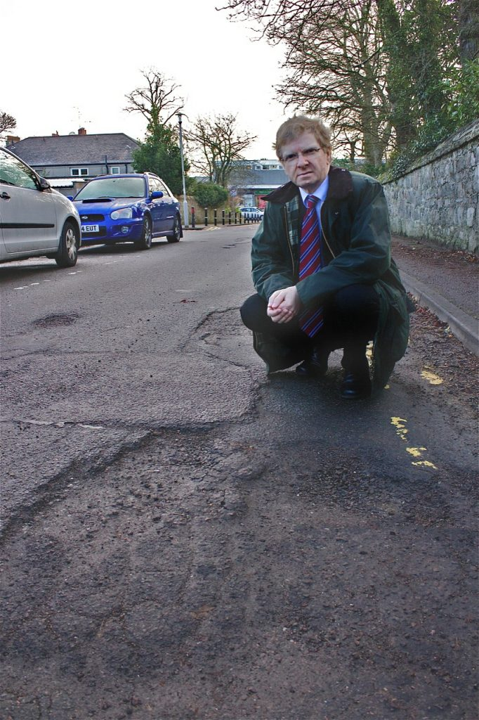 Photo of Ian Yuill at pothole