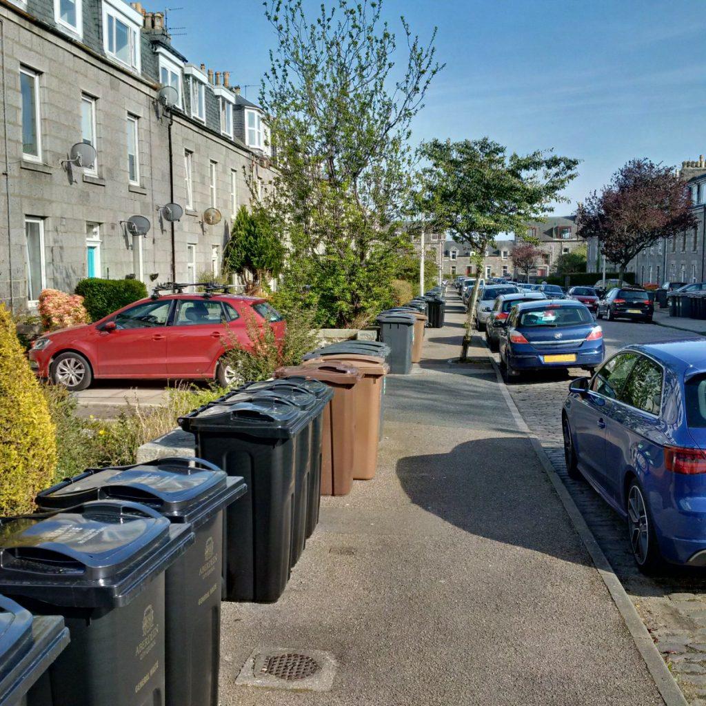 Photo of wheelie bins on a pavement
