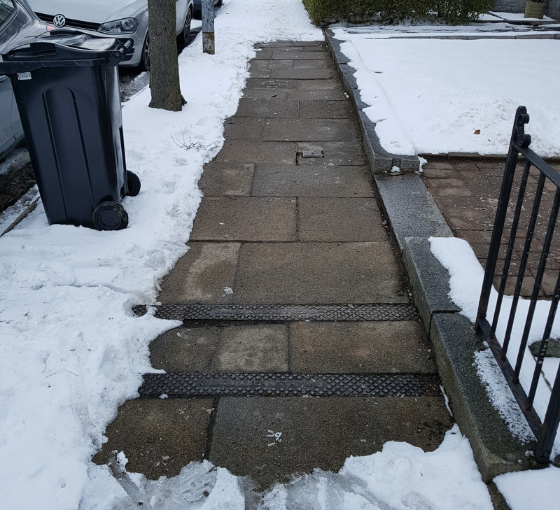 Photo of pavement cleared of snow