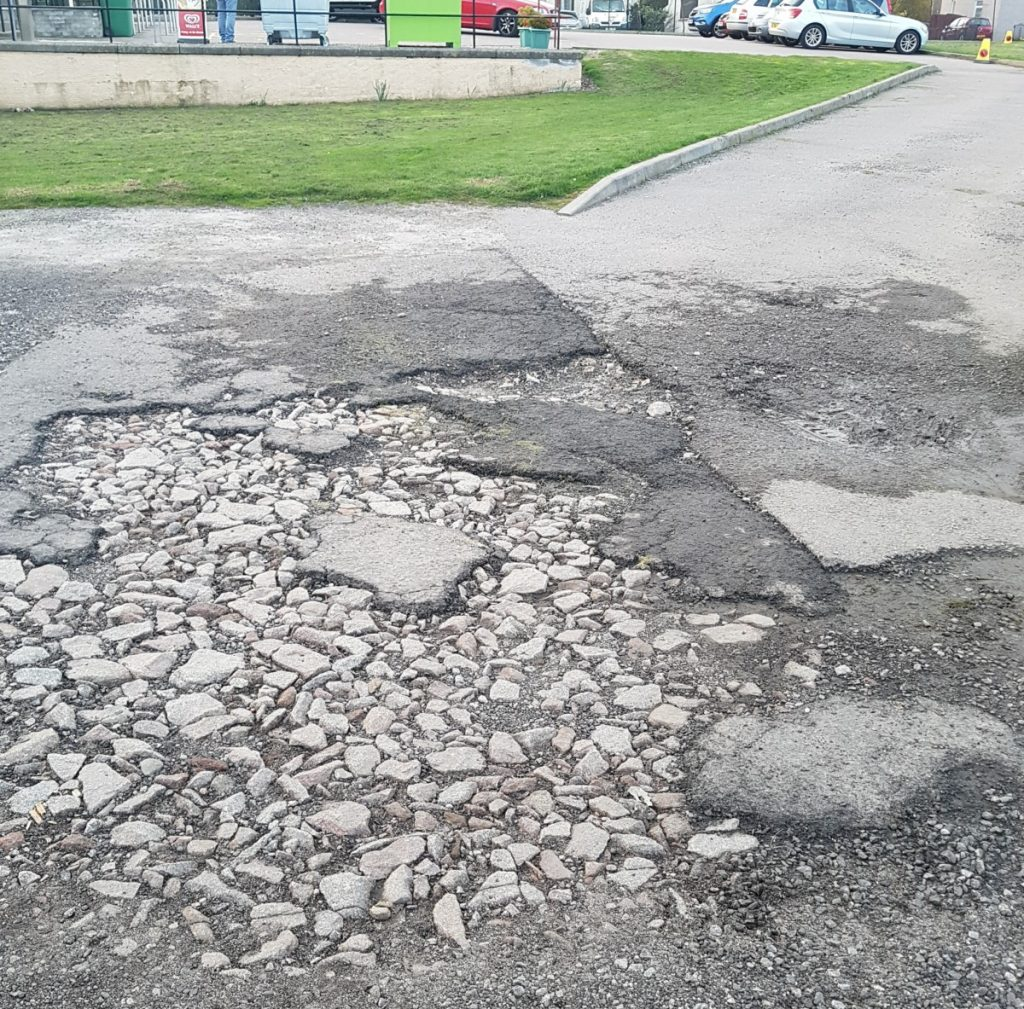Photo of crater in Inchgarth Community Centre car park