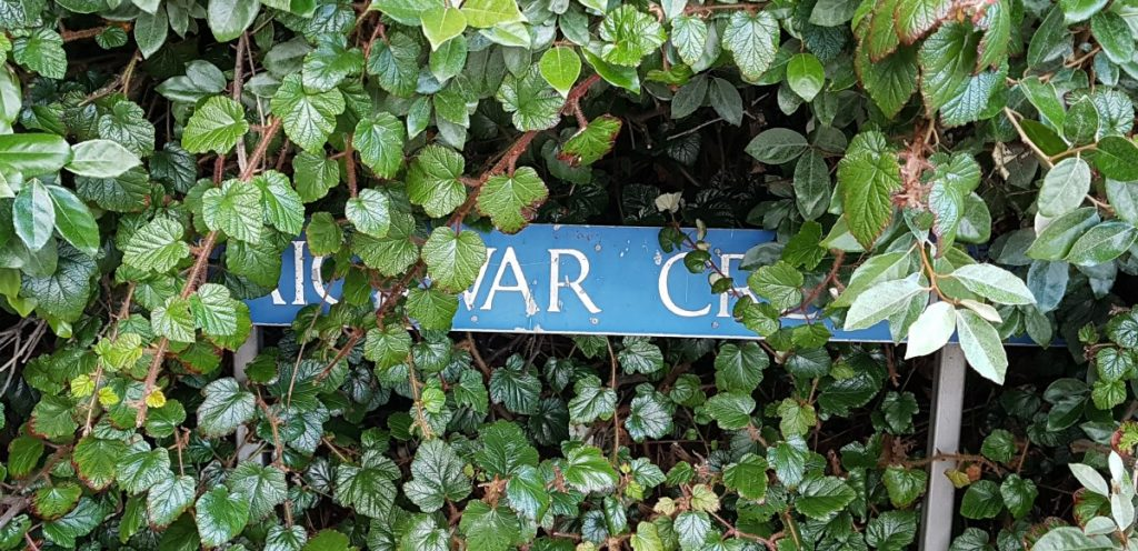Photo of obscured street name sign on Craigievar Crescent