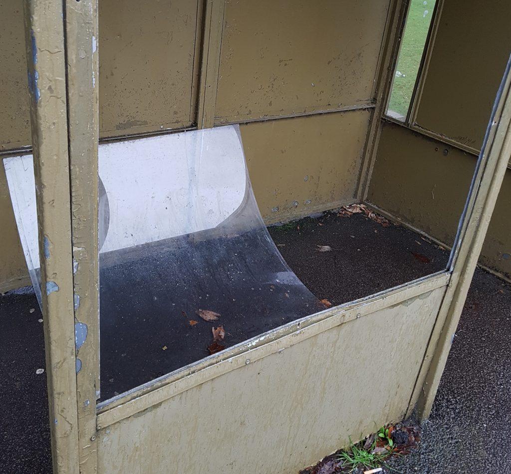 Photo of damaged bus shelter on Auchinyell Road