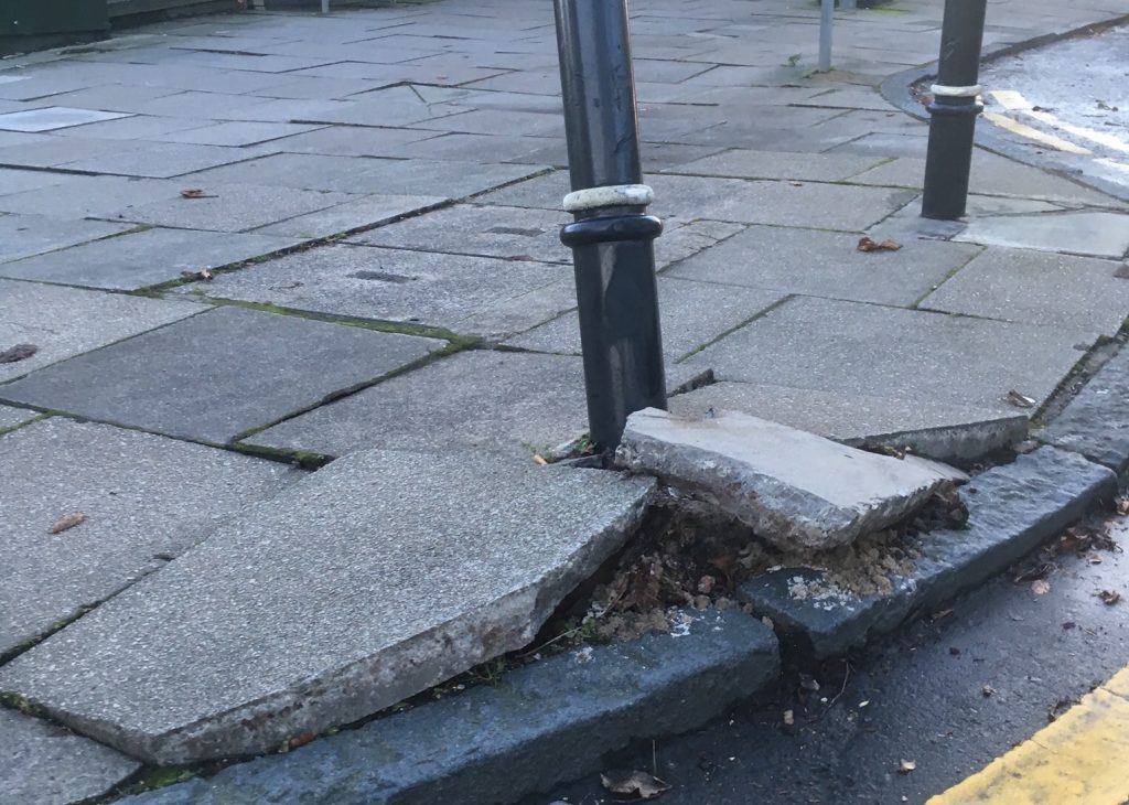 Photo of damaged bollard at junction of Great Western Road and Hammerfield Avenue
