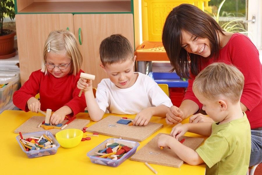Photo of teacher and children